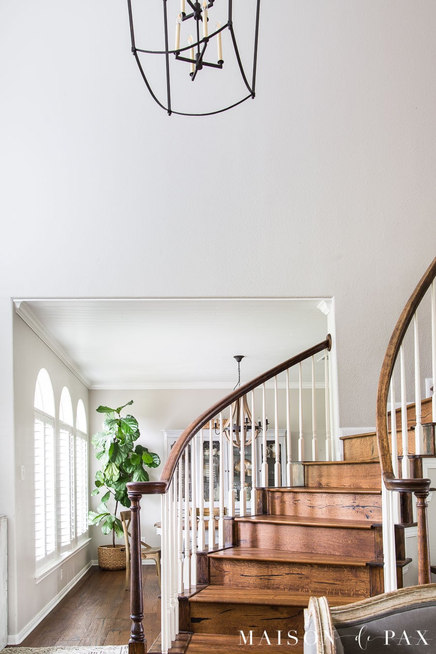 two story entryway and stairwell with large black lantern | Maison de Pax
