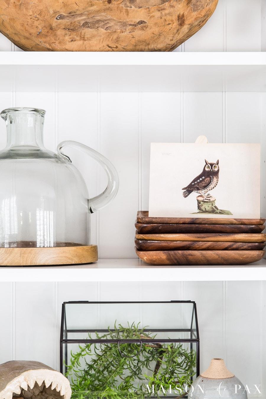 wood tones and vintage art on style shelves | Maison de Pax