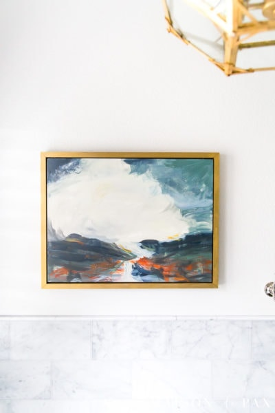 acrylic painting in gold frame hung above tub in master bathroom | Maison de Pax