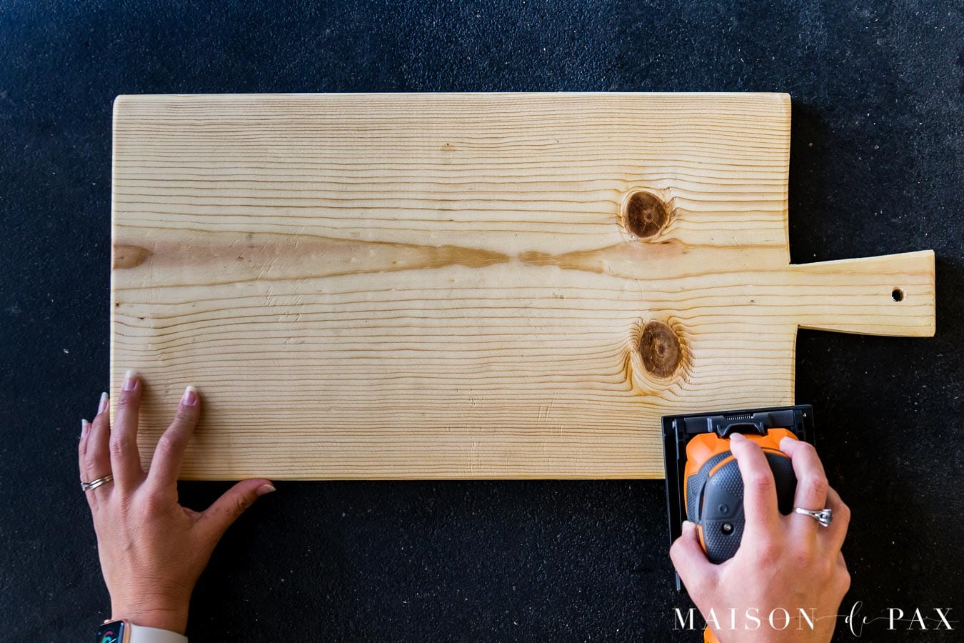 Sanding smooth edges of a pine common board for a cutting board | Maison de Pax
