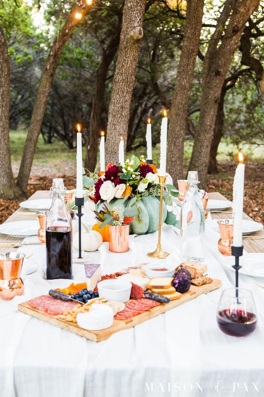 outdoor thanksgiving table with pumpkins and candles | Maison de Pax