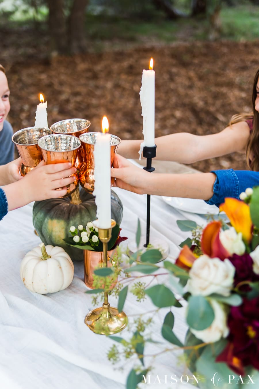cheers with copper cups at Thanksgiving table | Maison de Pax