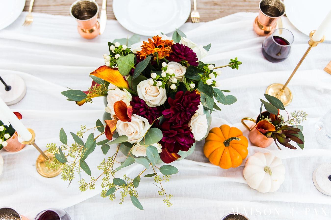 fall floral centerpiece and mini pumpkins on thanksgiving table | Maison de Pax