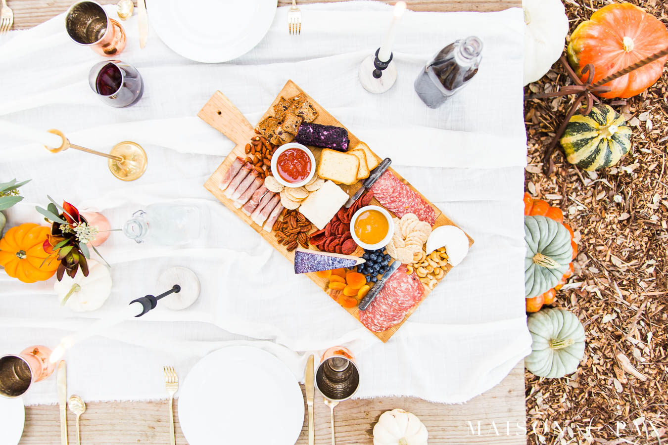 charcuterie board with reds, purples, and oranges for a Thanksgiving table | Maison de Pax