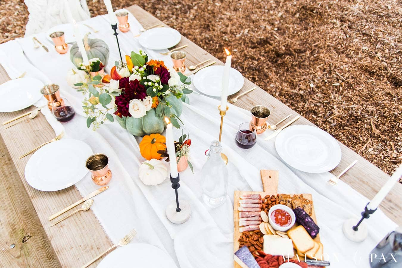 Thanksgiving table with pumpkins, metallics, and charcuterie board | Maison de Pax