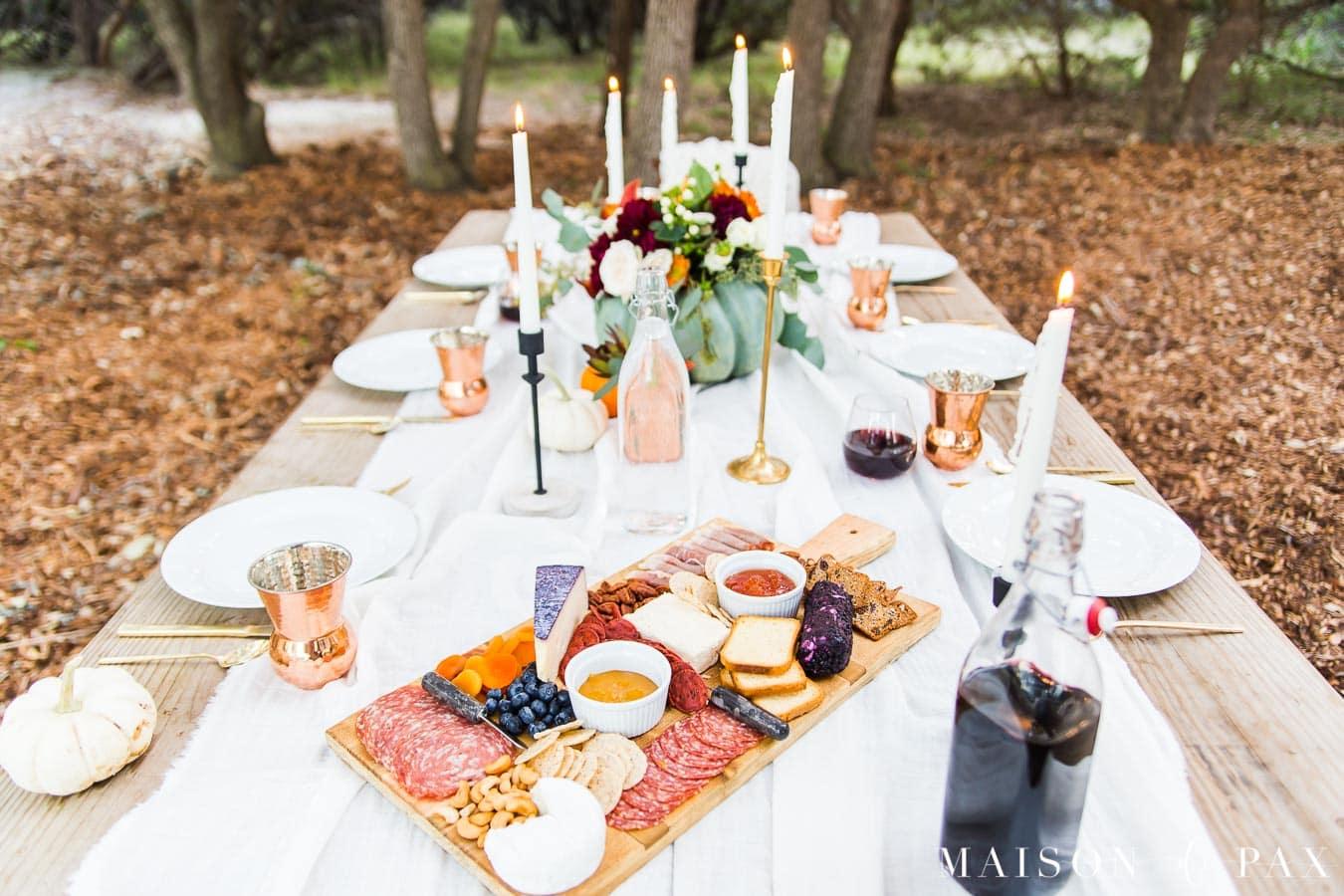 friendsgiving ideas: charcuterie board on thanksgiving table | Maison de Pax