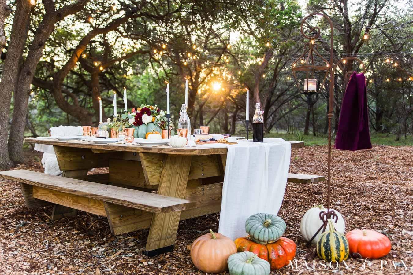 outdoor friendsgiving table with pumpkins | Maison de Pax