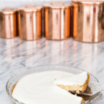 pumpkin cheesecake with sour cream topping in glass pie pan | Maison de Pax