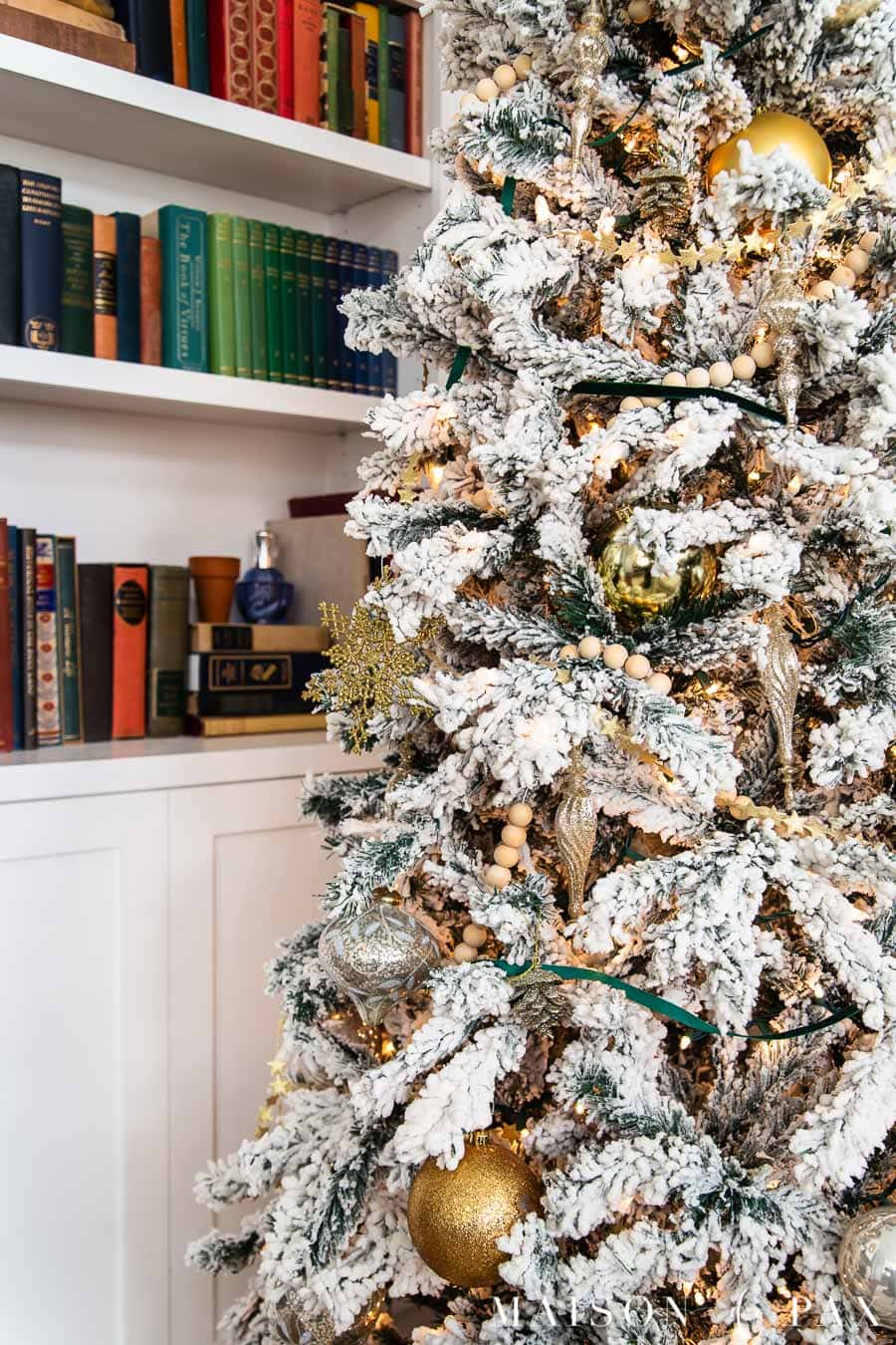 flocked Christmas tree with wood and metallic ornaments | Maison de Pax