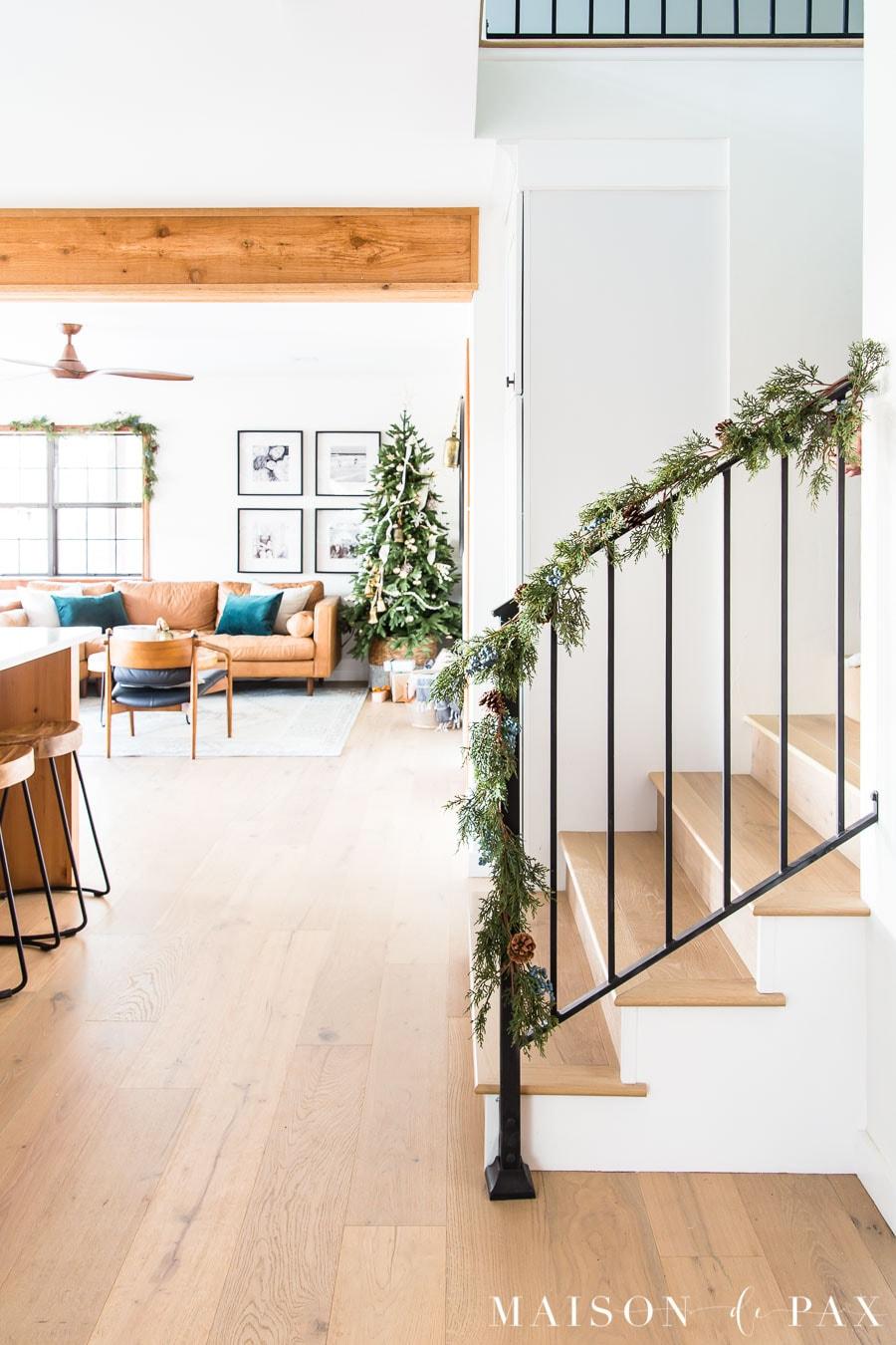 black metal stair railing with garland in fresh modern farmhouse | Maison de Pax