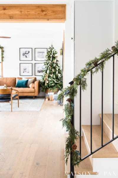green garland on black metal stair railing | Maison de Pax
