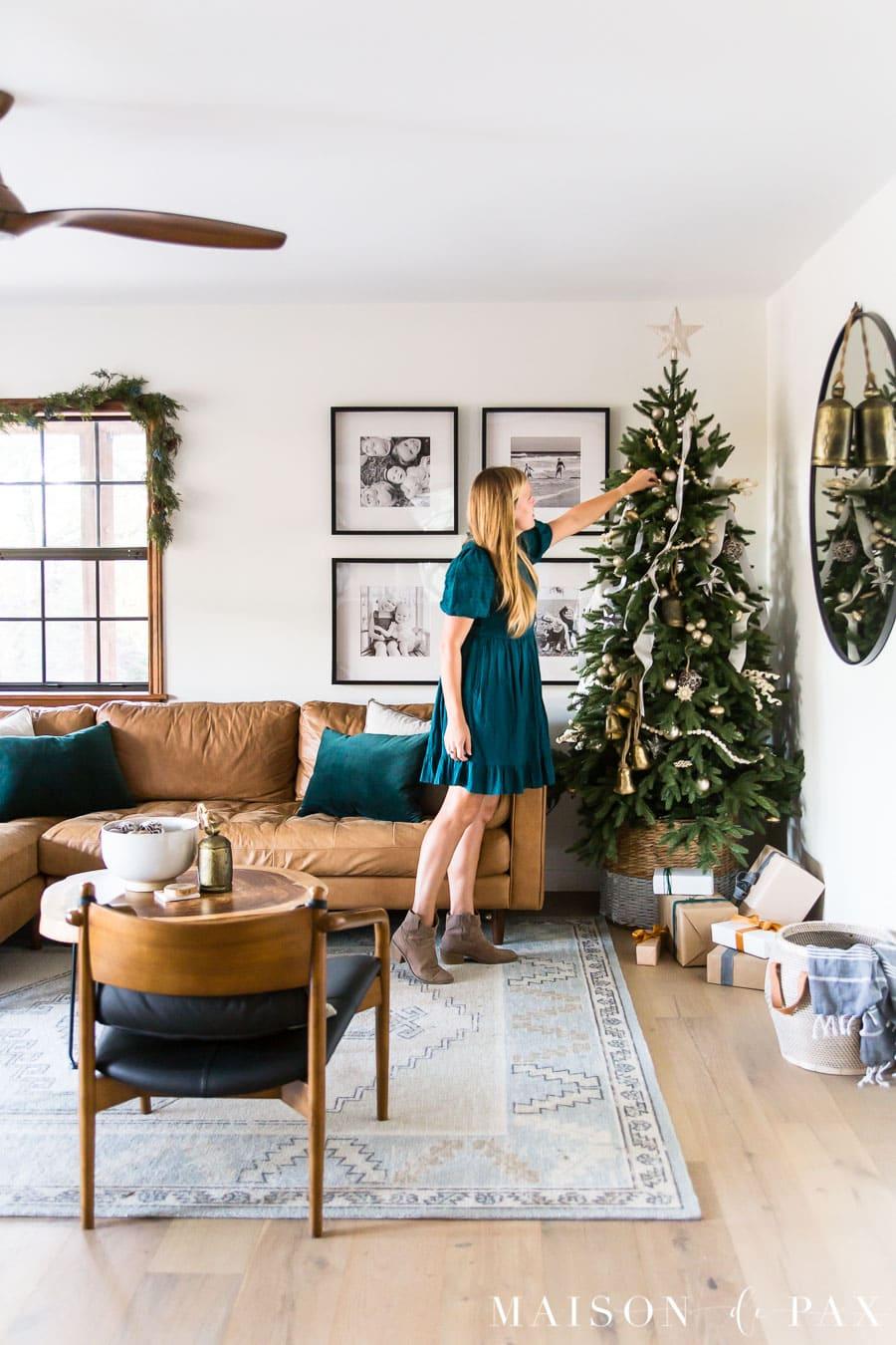 woman decorating tree in modern farmhouse living room | Maison de Pax