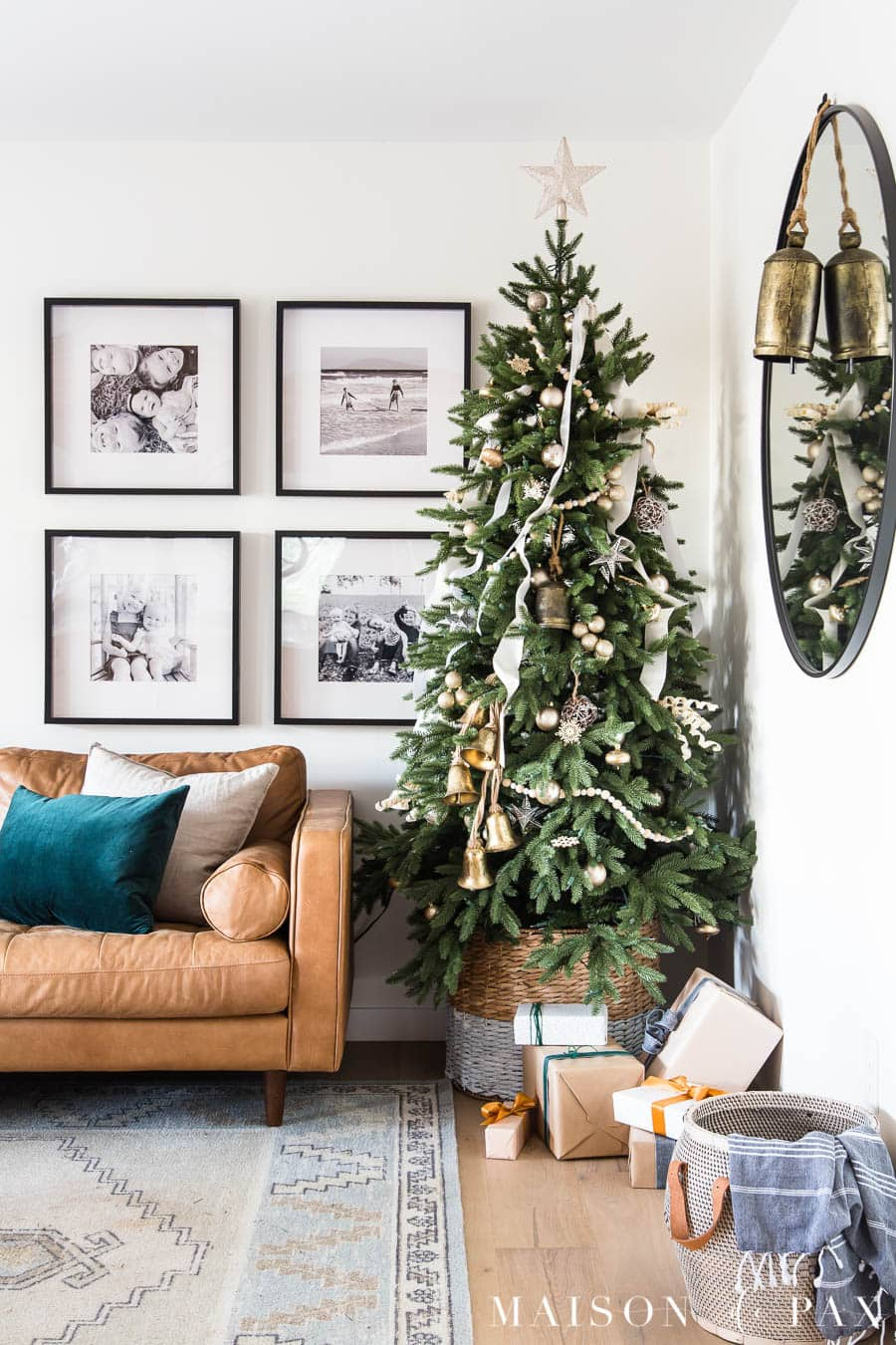 green tree with white ribbon, gold ornaments | Maison de Pax