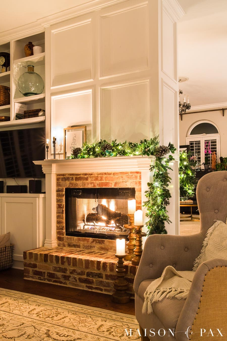 fireplace with asymmetrical garland and candles | Maison de Pax