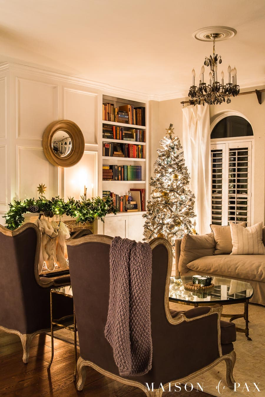 Living room lit up at night by Christmas tree and string lights | Maison de Pax