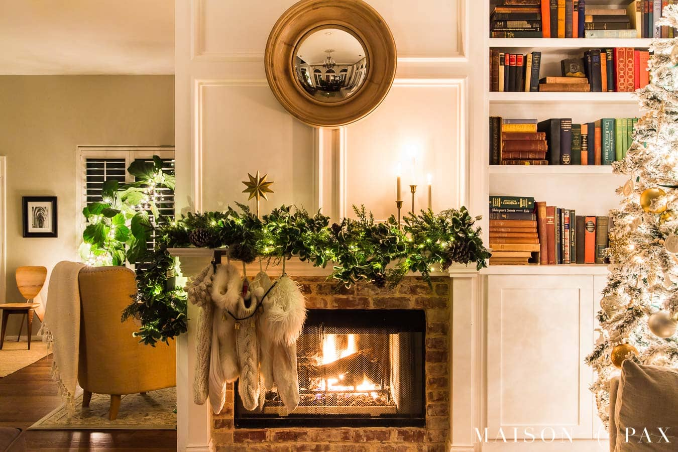 fireplace with asymmetrical garland and lights | Maison de Pax