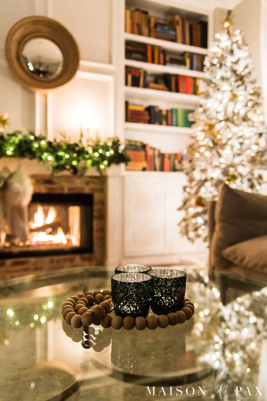 flocked christmas tree and fireplace all lit up at night   Maison de Pax