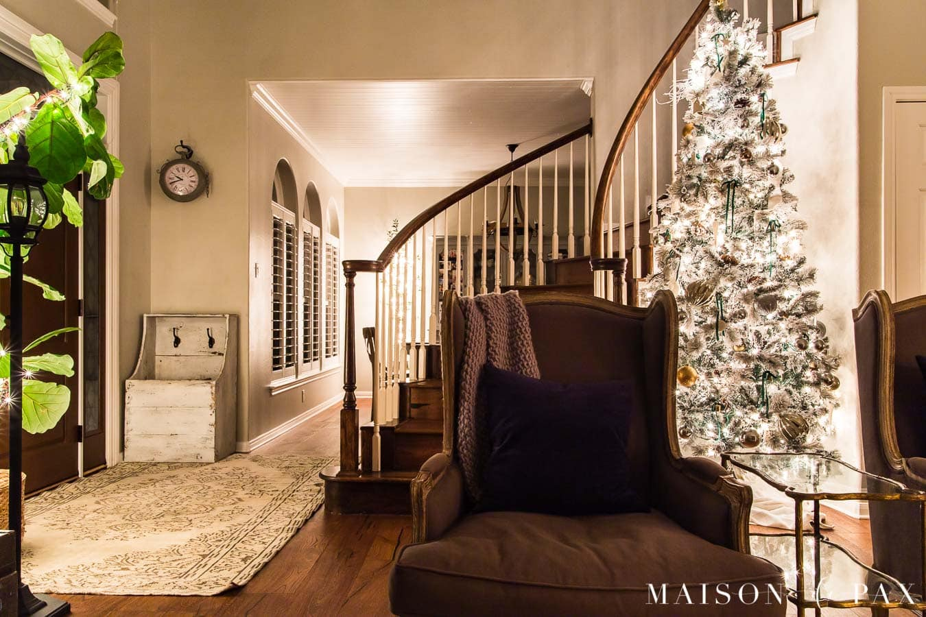 entryway and stairwell with Christmas lights | Maison de Pax