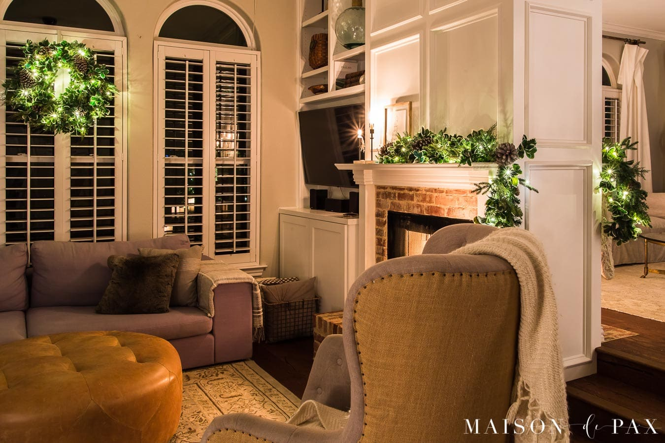 two sided fireplace with garland and Christmas lights   Maison de Pax