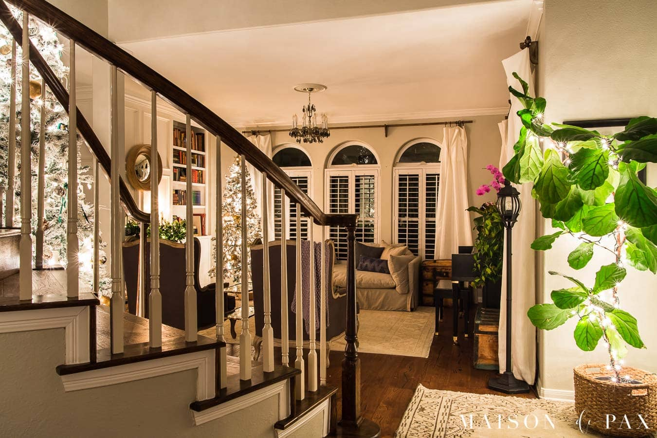 staircase and entryway with Christmas lights   Maison de Pax
