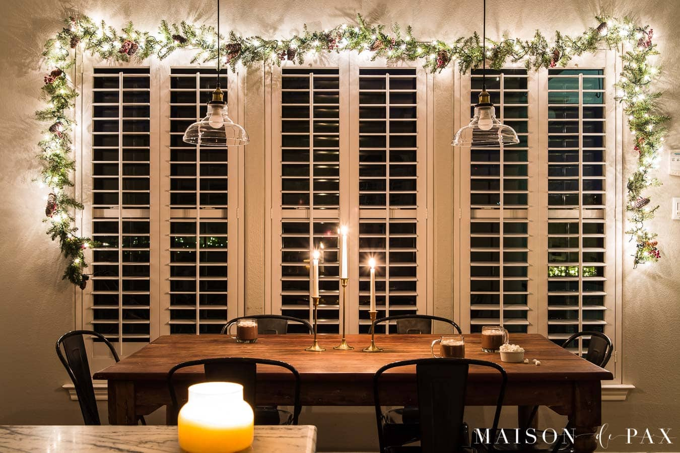 large windows with garland with lights | Maison de Pax