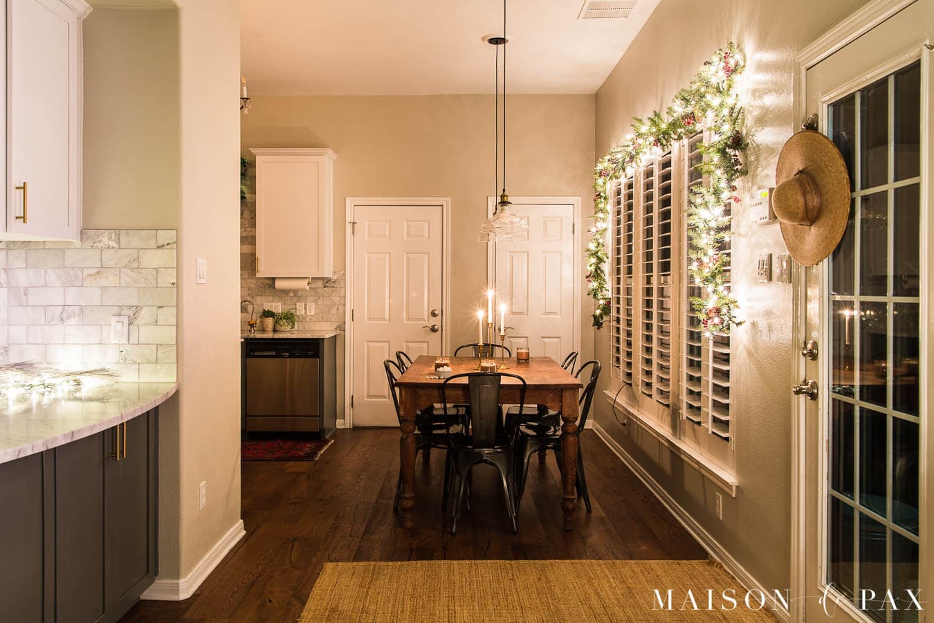 kitchen table and bar with twinkly lights and garland | Maison de Pax
