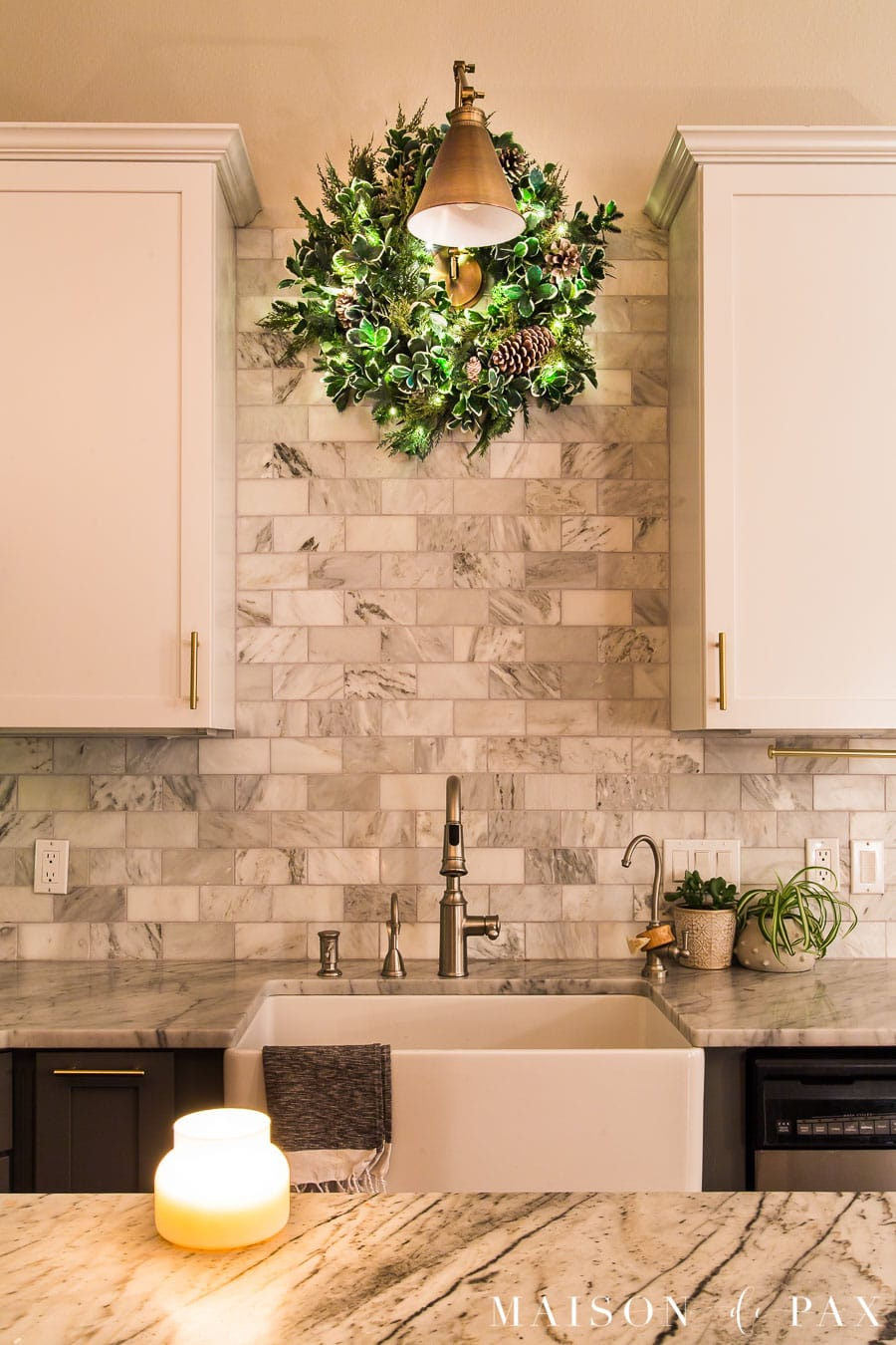 wreath with twinkle lights above kitchen sink | Maison de Pax
