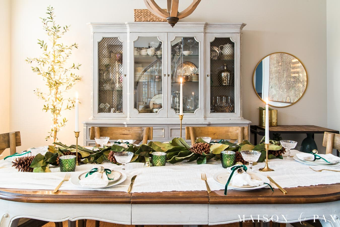 candlelit Christmas table with garland centerpiece | Maison de Pax