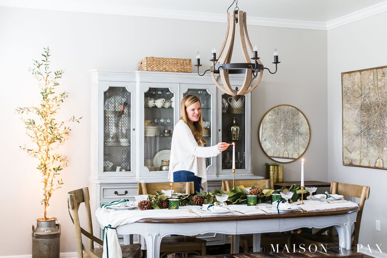 lighting candlestick on christmas table centerpiece | Maison de Pax