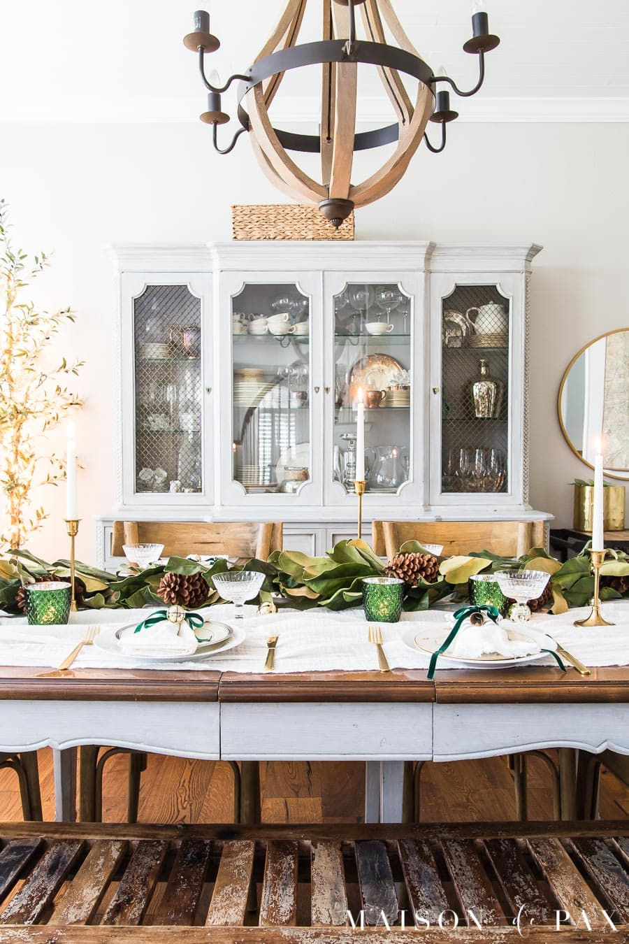 table decorated for Christmas dinner with bells and green ribbon | Maison de Pax