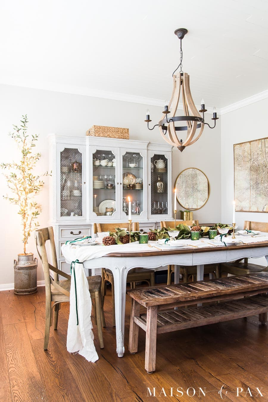 table decorated for holidays with magnolia garland | maison de pax