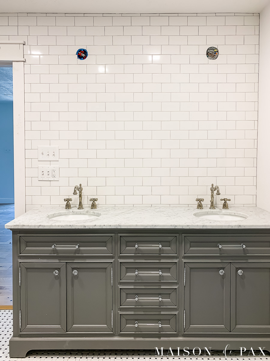 subway tile walls and gray double vanity with marble top | Maison de Pax