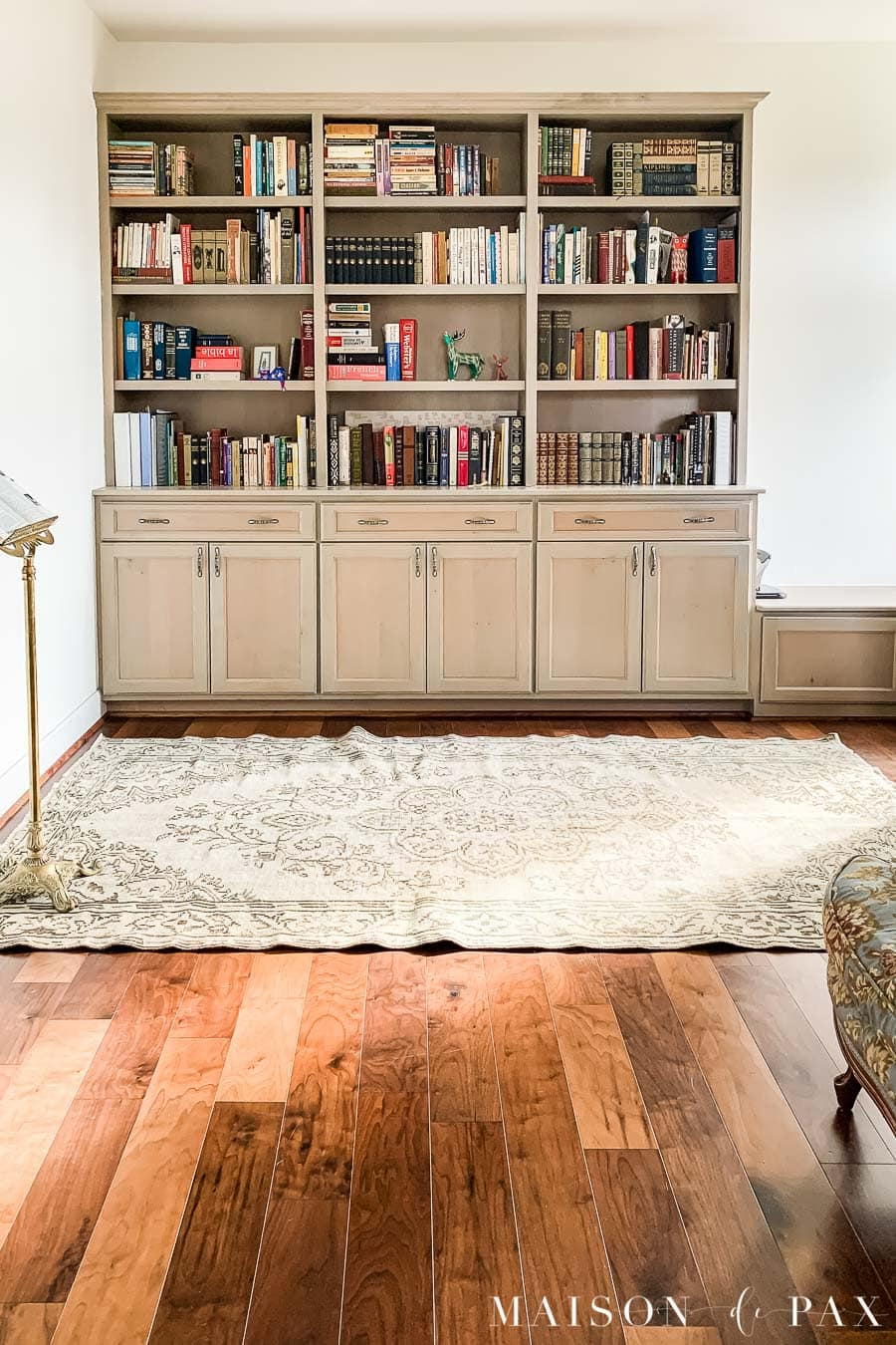 gray stained bookcases in an office with SW Alabaster walls | Maison de Pax
