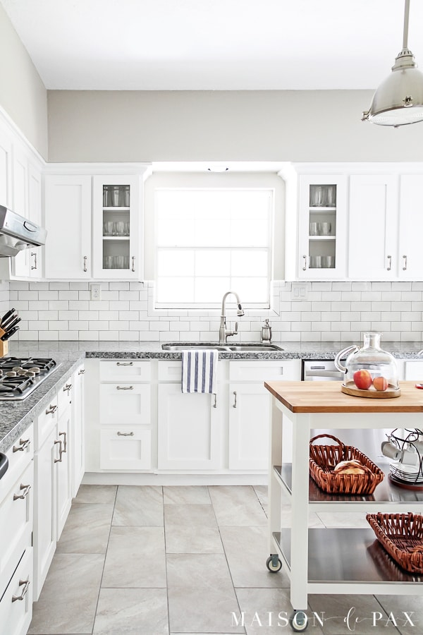 white kitchen with subway backsplash and delorean gray grout