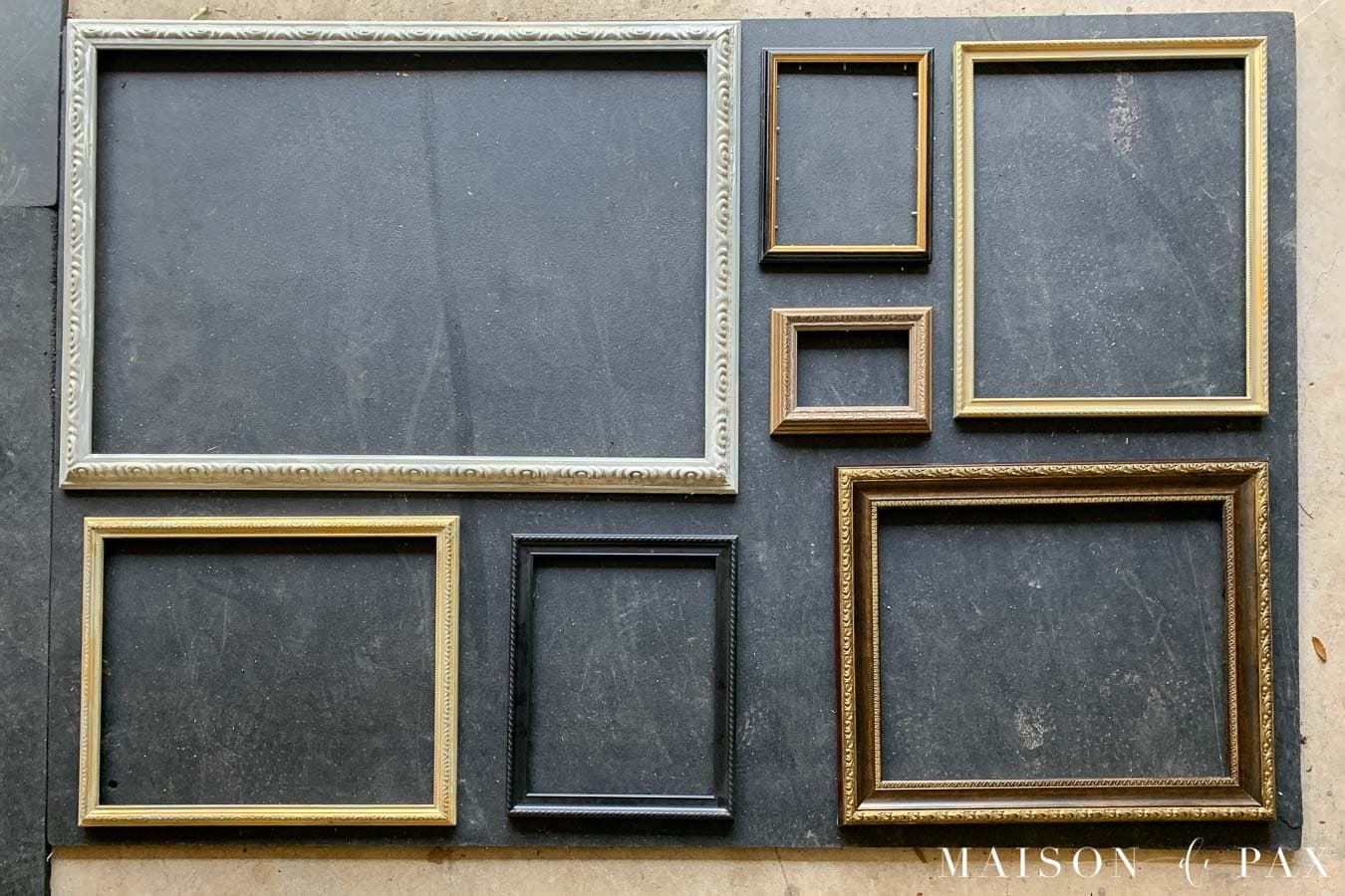 frames laid out in gallery wall format on ground | Maison de Pax