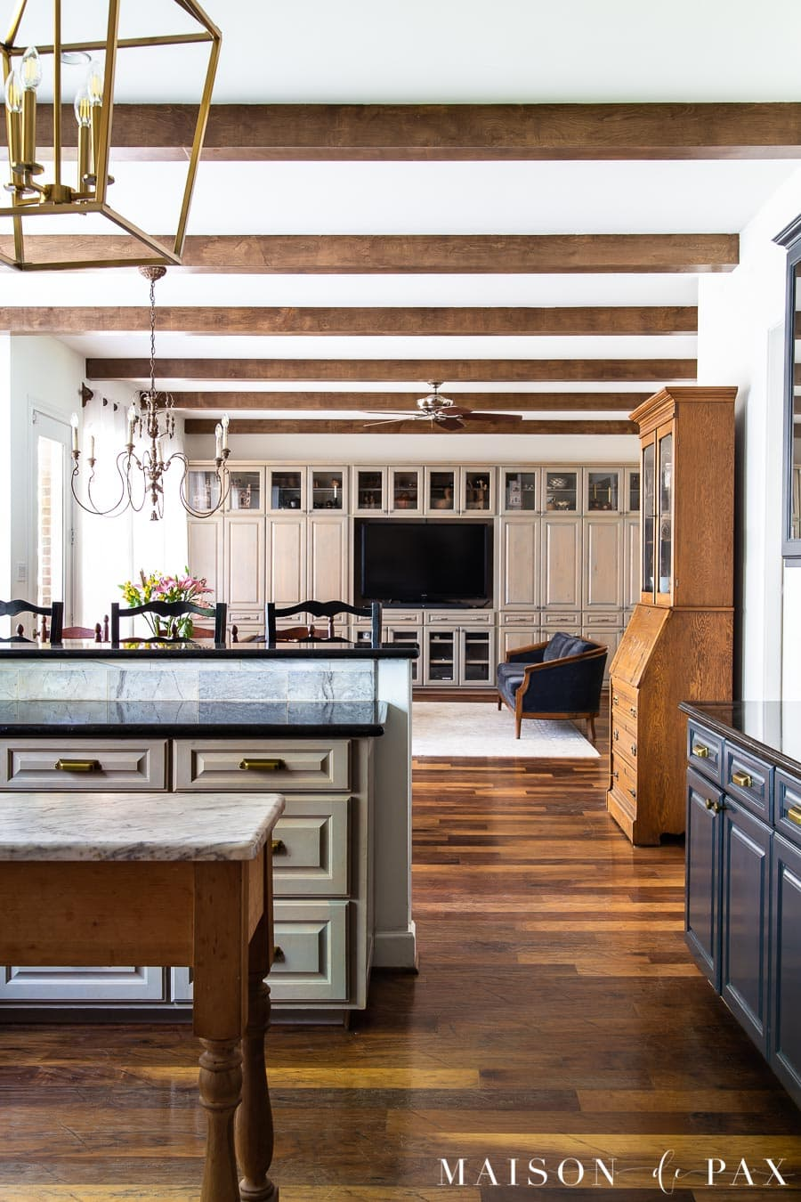open kitchen living with built in cabinets in gray wood