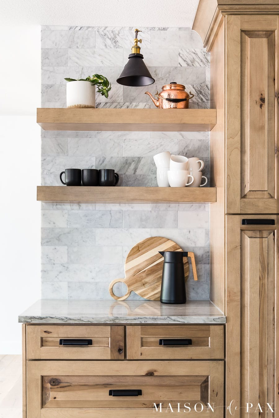 coffee bar with open shelves and marble backsplash