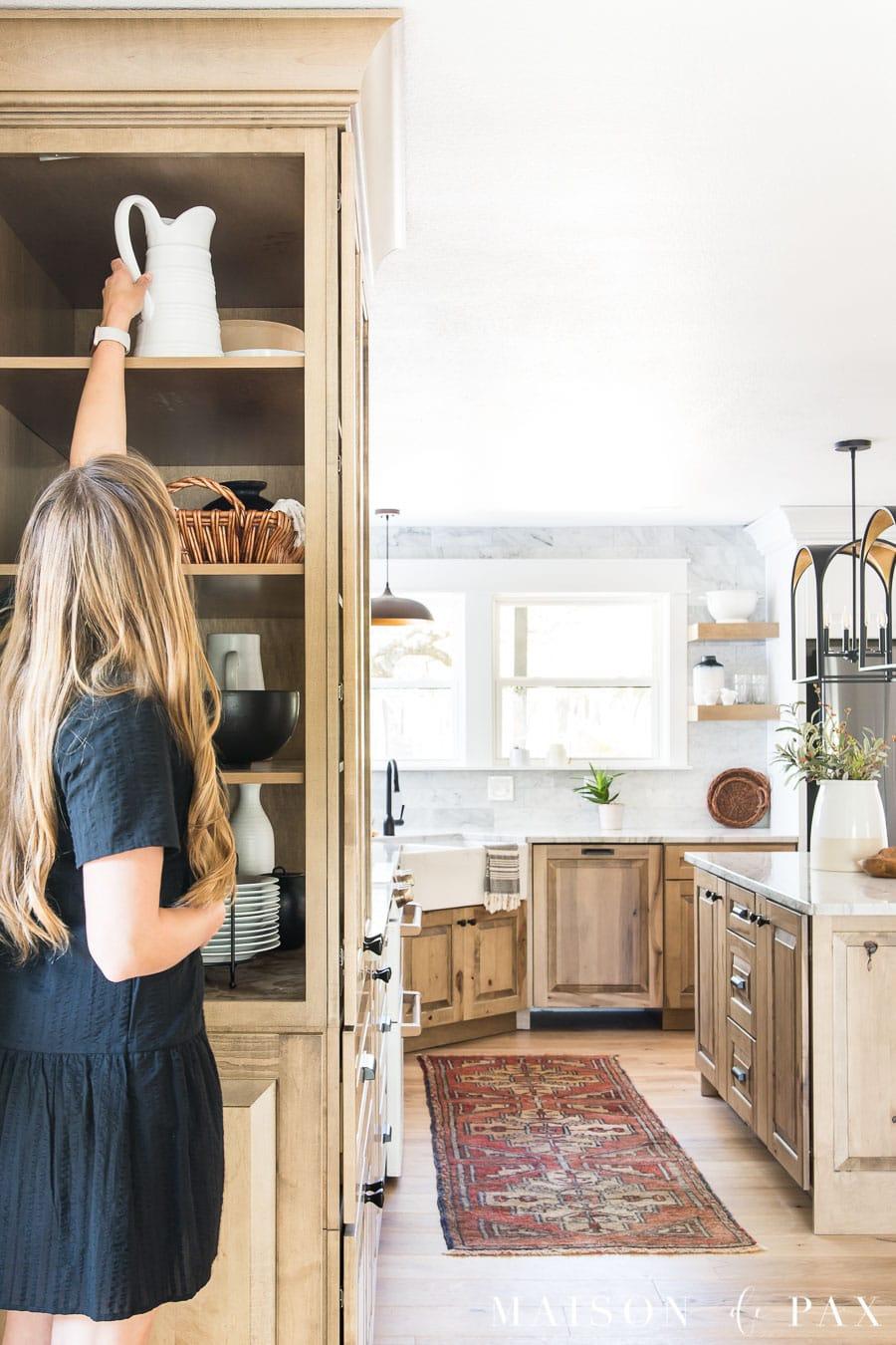 side access to deep decorative cabinet in kitchen - brilliant storage solution!