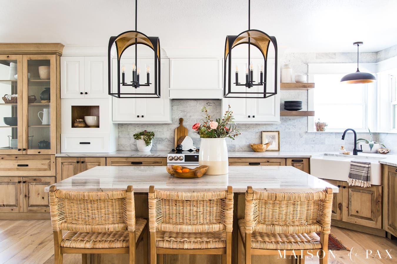 white and wood kitchen cabinets with large island