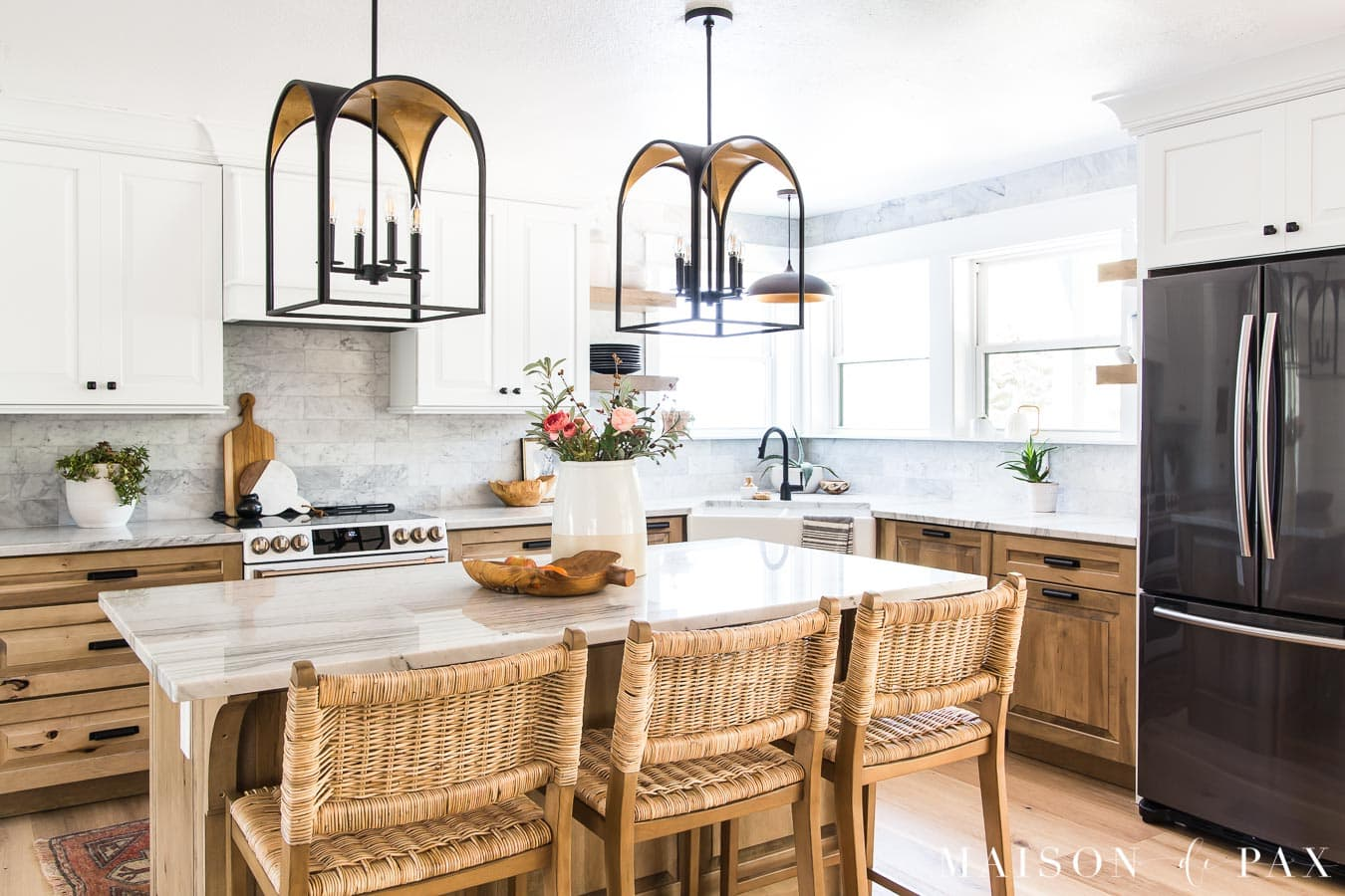 kitchen with island and white and wood cabinets