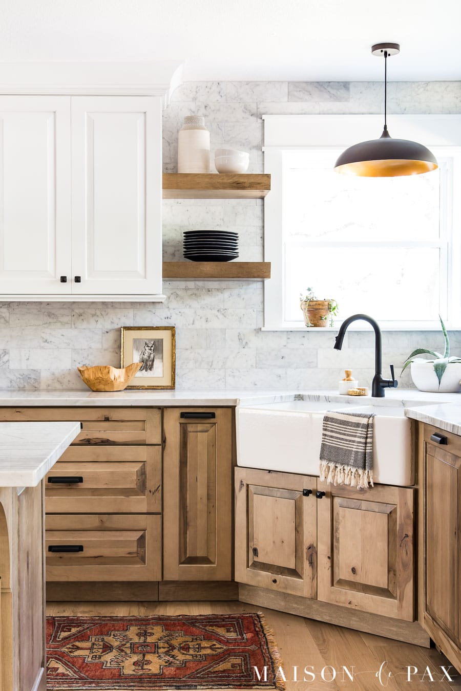 light wood lower cabinets with white upper cabinets