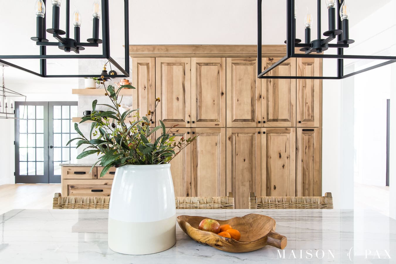 rustic natural wood cabinets in modern kitchen with quartzite countertops