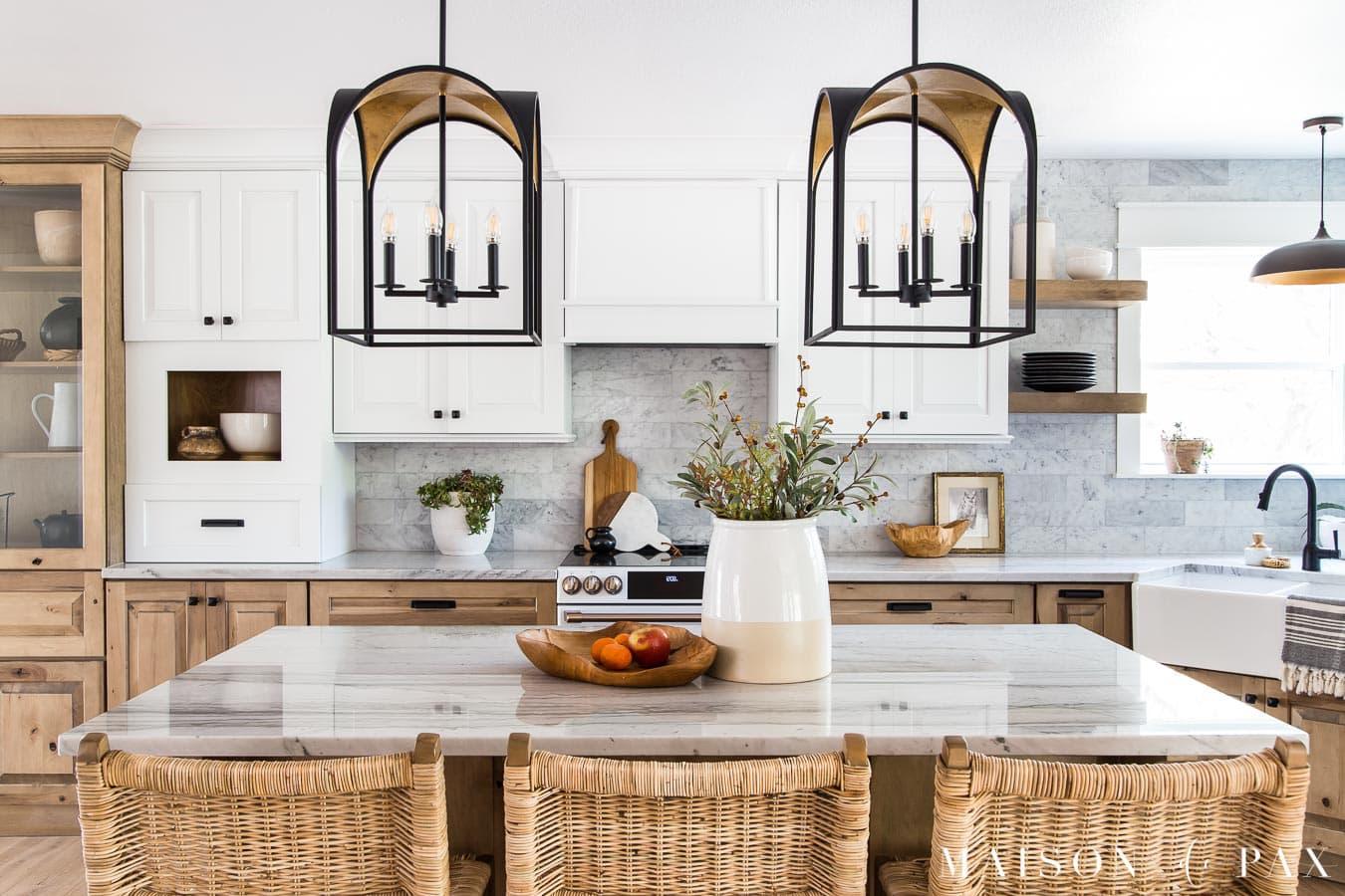 black and gold lantern pendant lighting above kitchen island | Maison de Pax