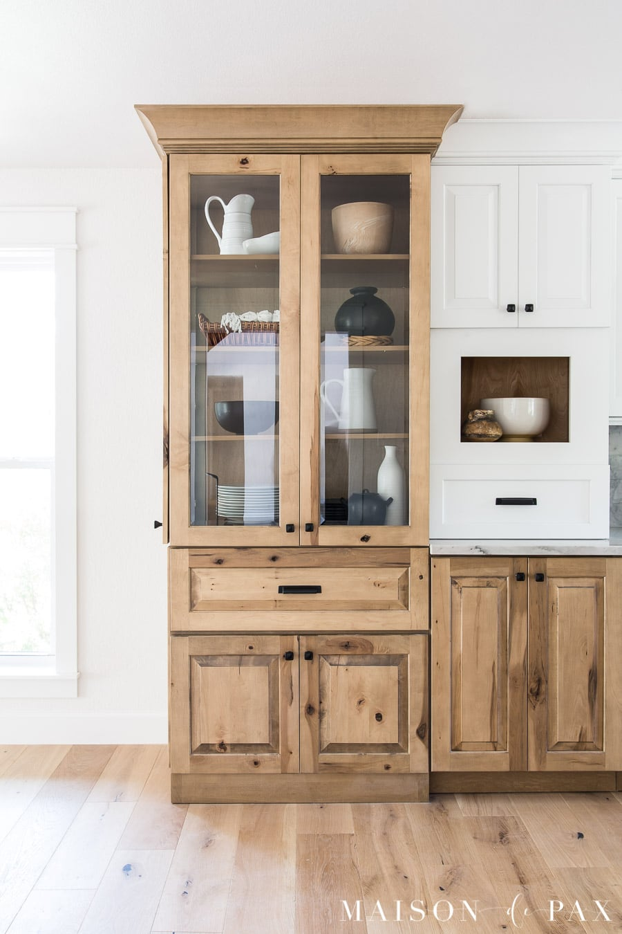 floor to ceiling decorative cabinet in kitchen