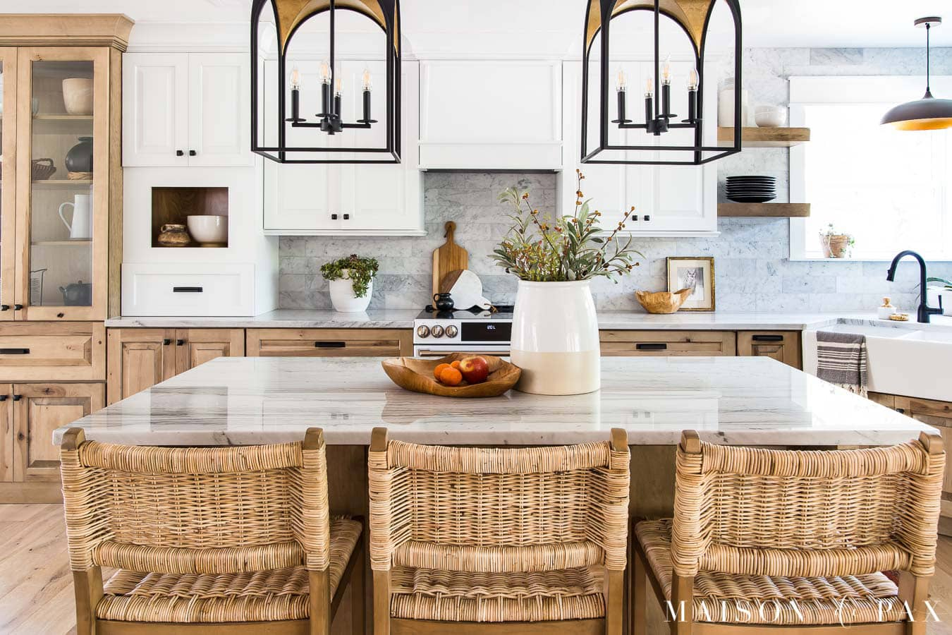 white and wood kitchen cabinets with quartzite counters