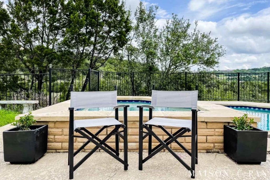 black and gray outdoor director's chairs by pool | Maison de Pax