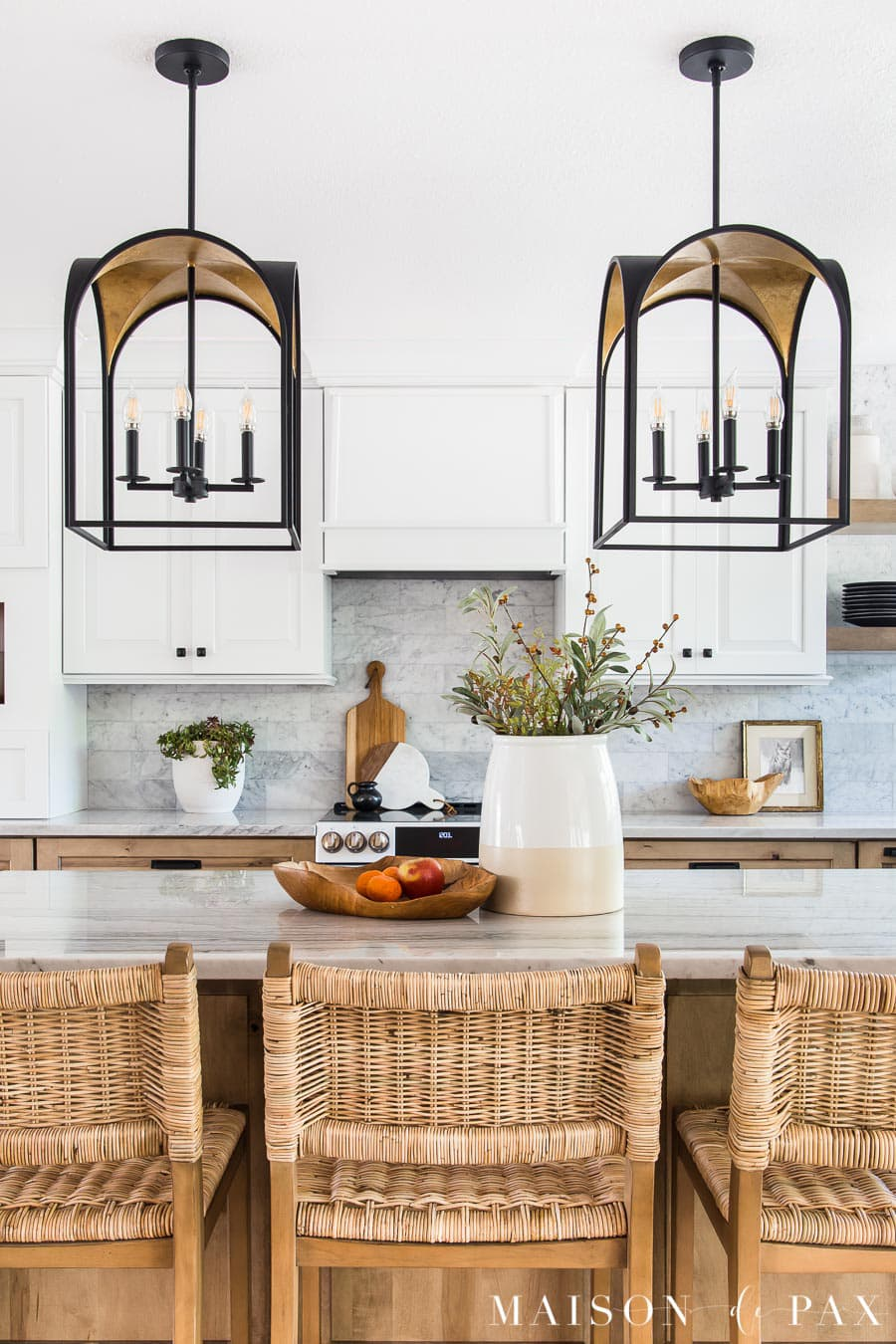 white and wood kitchen with black and gold island pendant lights | Maison de Pax