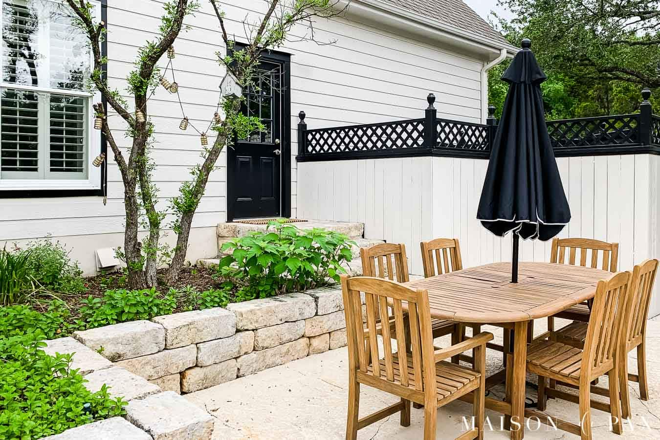 outdoor dining space black and white house teak furniture