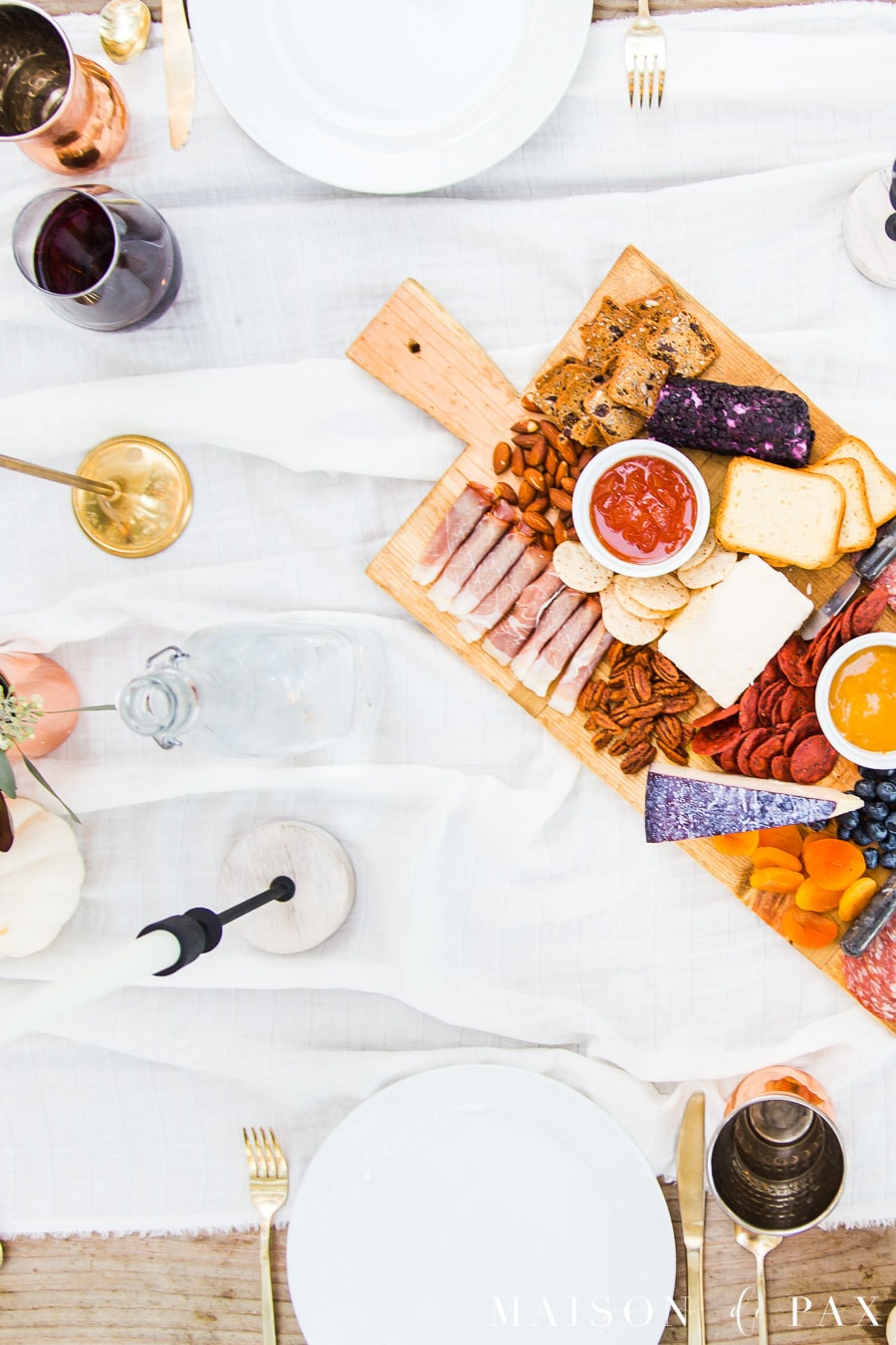 outdoor dining ideas charcuterie board candlesticks