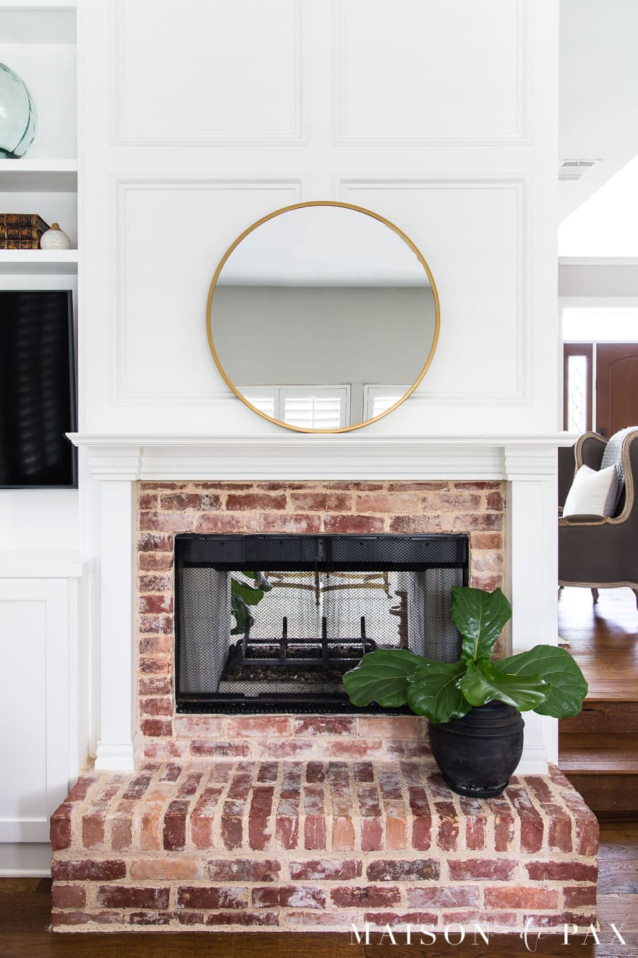 round mirror above mantel and fiddle leaf fig on hearth | Maison de Pax